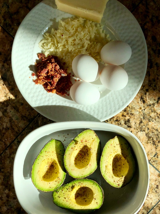 Salt and pepper to taste the split avocados.