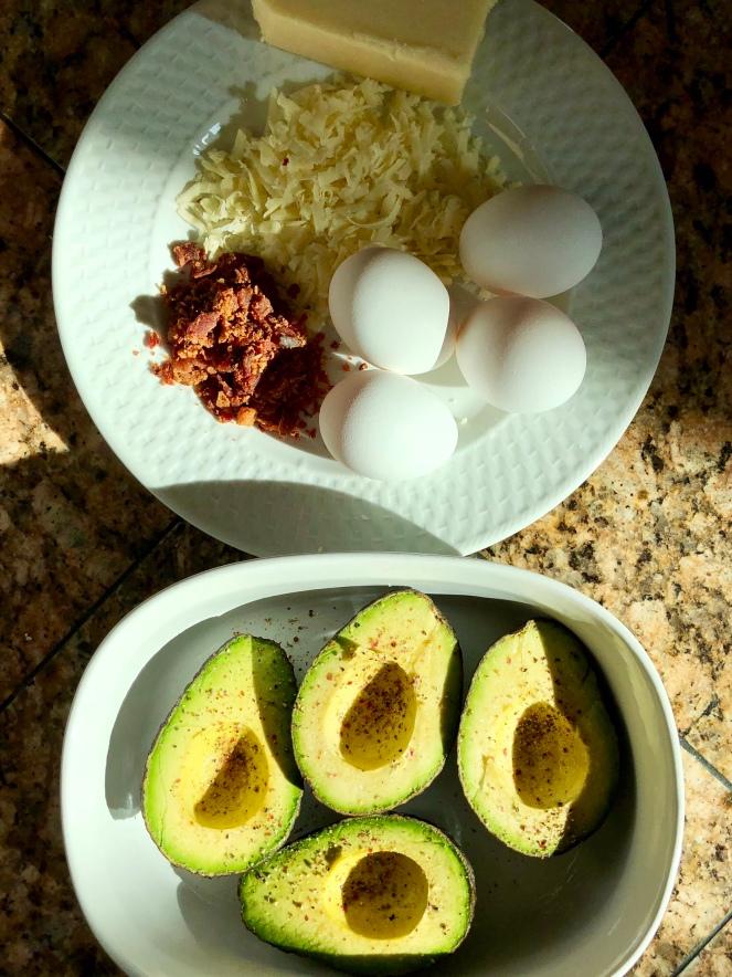 Salt and pepper to taste the split avocados.
